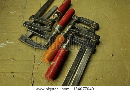 Used equipment, clamps carpentry tools close to