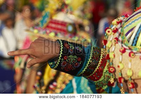 ARICA, CHILE - FEBRUARY 11, 2017: Tinkus Dance Group dressed in ornate costumes performing a traditional dance during a street parade at the annual Carnaval Andino con la Fuerza del Sol.