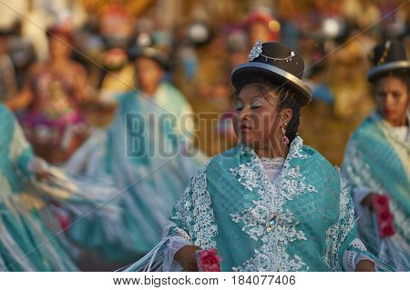 ARICA, CHILE - FEBRUARY 11, 2017: Morenada dancers performing during a street parade at the annual Carnaval Andino con la Fuerza del Sol in Arica, Chile.