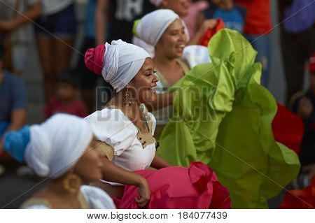 ARICA, CHILE - FEBRUARY 11, 2017: Group of dancers of Africa descent (Afrodescendiente) performing at the annual Carnaval Andino con la Fuerza del Sol in Arica, Chile.