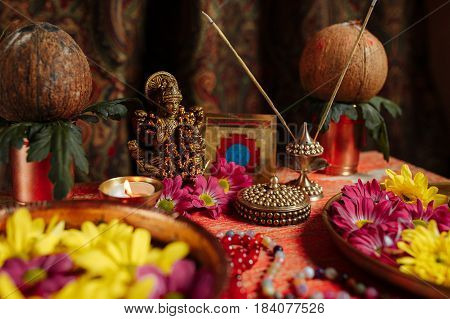 Photo On Buddhist Themes. Close-up. Buddha Statue, Flowers On A Tray And A Candle