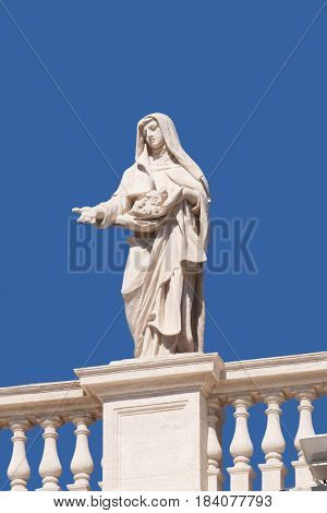 ROME, ITALY - SEPTEMBER 02: St. Elizabeth of Portugal, fragment colonnade of St. Peters Basilica. Papal Basilica of St. Peter in Vatican - the world largest church, in Rome, on September 02, 2016.