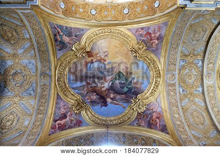ROME, ITALY - SEPTEMBER 02: The fresco of virtues of Hope and Truth on the little cupola of side nave in Basilica dei Santi Ambrogio e Carlo al Corso by Pio Paolini, Rome, on September 02, 2016.