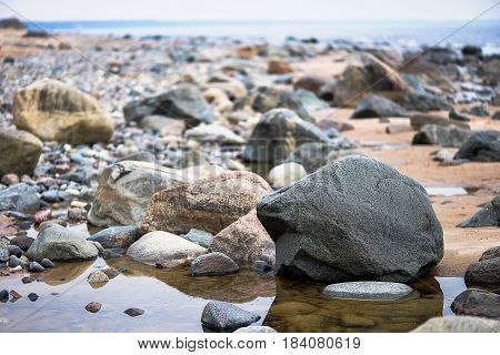 Close-up photography. Full sea edge with colored stones.