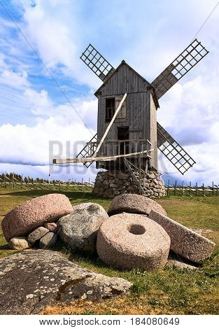 Rural landscape with old mills and millstones.