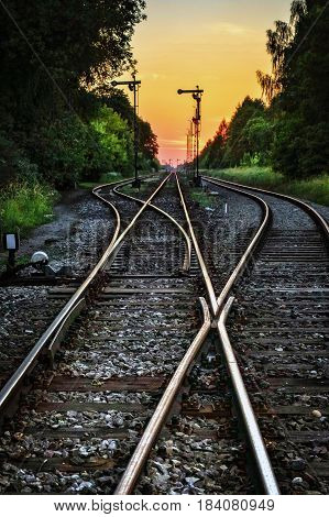 Abstract landscape with railway track at sunset.