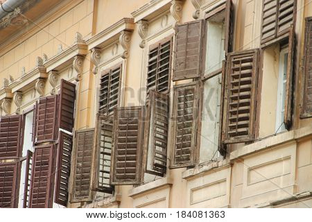 Opened windows of an old house in the medieval city of Sibiu. Romania