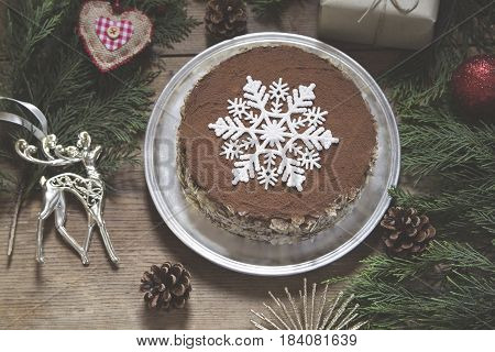 Christmas cocoa and almond torte with decoration