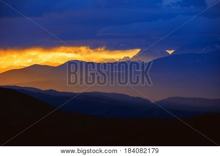 Beautiful landscape of sunset strip and mountain peaks. Altay mountains, Russia