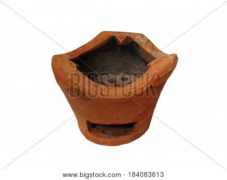Clay stove isolated on white background. It made for cooking boiler and stove,Traditional charcoal burning clay stove ancient in a rustic house.