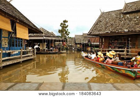 PATTAYA THAILAND - 27 Apr 2017: Travel and shopping in Pattaya Floating Market four regions where have traditional commercial boats and villagers do about traditional foods and souvenirs,Vintage style
