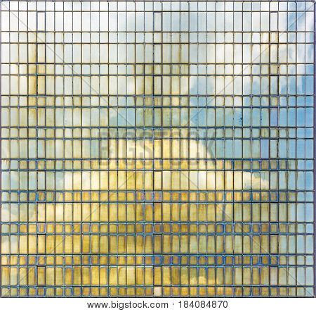 Background photo. Reflection of the sky in the steel tiles panel