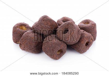 Crunchy corn chocolate snacks on a white background