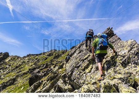 Three Climbers On The Rock Ridge.