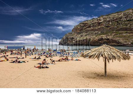 Porto Cruz, Portugal - April 29, 2017: Madeira ocean sand beach in resort Porto Cruz, Portugal.