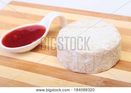 Cheese with white mold. Camembert or brie type with Cranberry sauce.. Healthy breakfast
