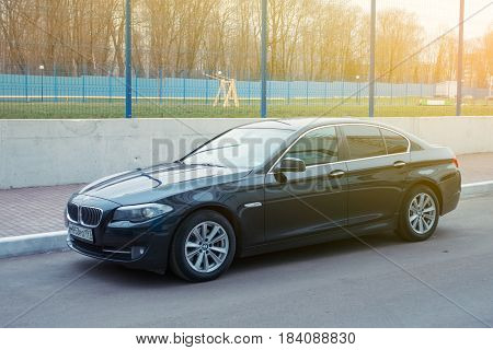 Smolensk, Russia - April 25, 2017: Luxury Bmw 5-series  parked in suburbia of Smolensk City, new model of the brand BMW.