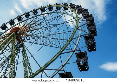 Ferris wheel in the amusement park in evening Odessa, Ukraine.