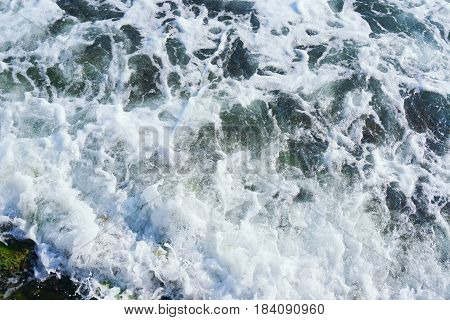 strong sea wave splashing on the sandy beach shore