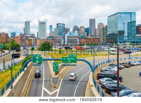 Boston - June 2016, MA, USA: Boston skyline in summer day, panoramic view on buildings in downtown and highway with traffic
