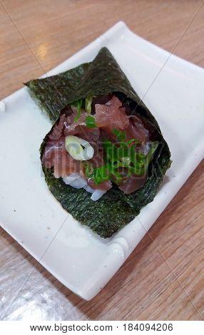 Fresh temaki stuffed with raw tuna fish