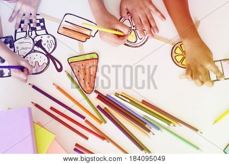 Children participating in drawing class