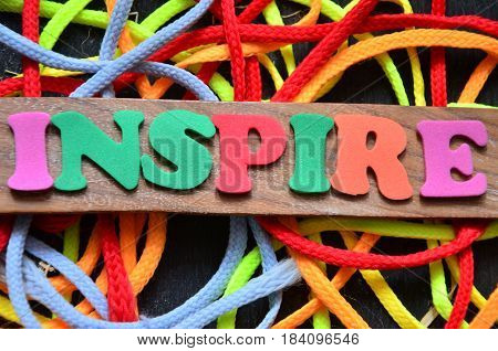 word inspire on a  abstract colporful background