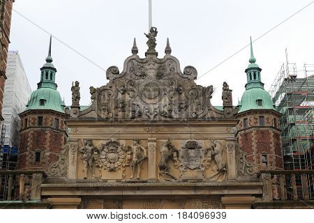 HILLEROD, DENMARK - JUNE 30, 2016: These are blazons above the gate of Frederiksborg Castle the residence of the Danish kings.