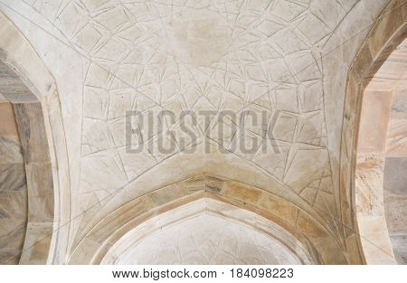 Agra, India - February 19, 2017 Three types of inlay are used to ornament the buildings of the Taj complex. Stone intarsia whereby colored marbles are inlaid into easily workable sandstone is the most basic type of inlay.