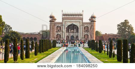 Agra, India - February 19, 2017 The main gateway of Taj Mahal which is about 93 feet in height is a masterpiece of fine inlay work in itself.