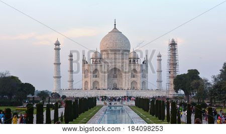 Agra, India - February 19, 2017 The Taj Mahal incorporates and expands on design traditions of Persian and earlier Mughal architecture.