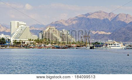EILAT, ISRAEL - MAY 10, 2011: View on the Red Sea and hotels with marina on central beach in Eilat - famous resort city in Israel and Middle East