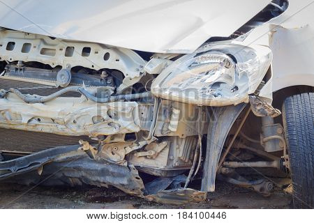 Details of a white car in a hard accident. Safety concept