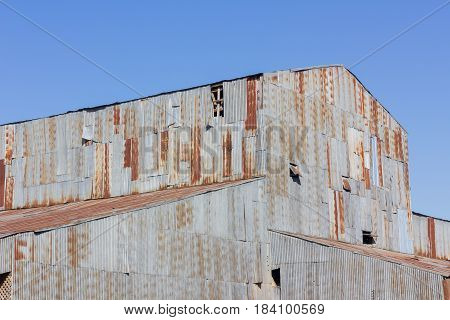 closeup old traditional house made of rusty galvanized iron