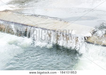 Small waterfall on the river in winter.