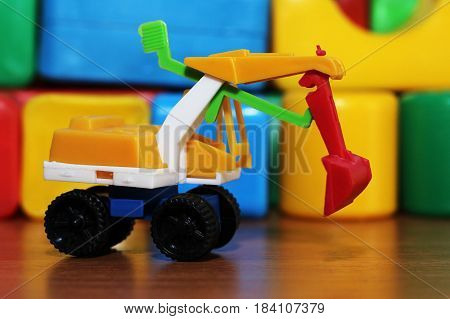 Car Toy On The Background Of Colored Cubes