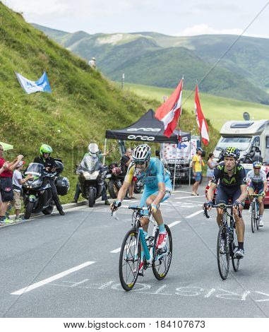 Col de PeyresourdeFrance- July 23 2014: Two cyclists Alessandro Vanotti of Astana Team and Imanol Erviti Ollo of Movistar Team climbing the road to Col de Peyresourde in Pyrenees Mountains during the stage 17 of Le Tour de France on 23 July 2014.