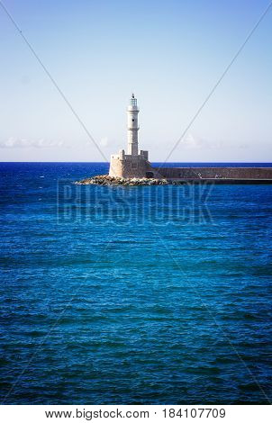bay of Chania with Aegan sea and lighthouse at sunny summer day, Crete, Greecer, retro toned