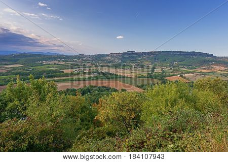 Panorama of a valley in the Ardeche with in the background the mountains of the Ardeche in France