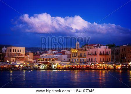 venetian habour of Chania with Aegan sea at night, Crete, Greecer, retro toned