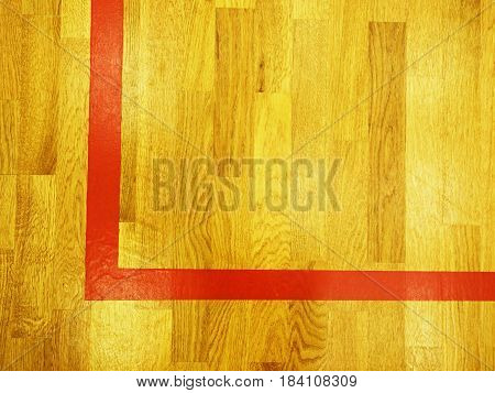 Red Corner Line. Worn Out Wooden Floor Of Sports Hall With Marking Lines