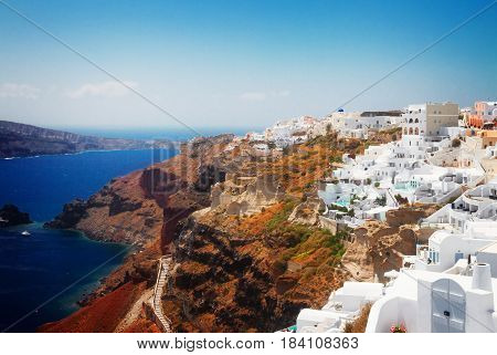 Oia, traditional greek village and Aegan sea waters, Santorini island, Greecer, retro toned