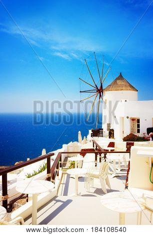 Windmill and blue Aegan sea at Oia, Santorini, Greecer, retro toned