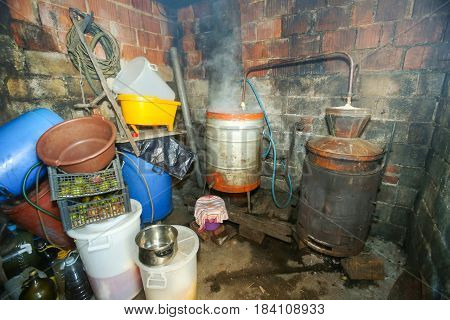 A view of the distillery boilers for making fruit brandy in an obsolete shed.