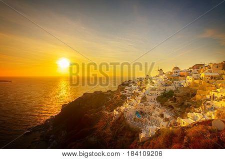 famouse sunset of Oia over Aegan sea, Santorini islandr, retro toned