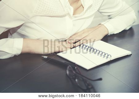 woman hand pen and table notebook on brick wall background