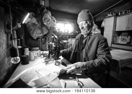 Man Sewing Fabric Bw