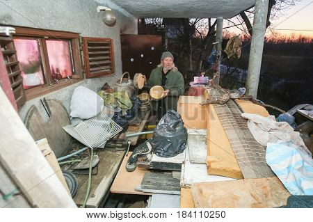 Old Man At Cluttered Terrace