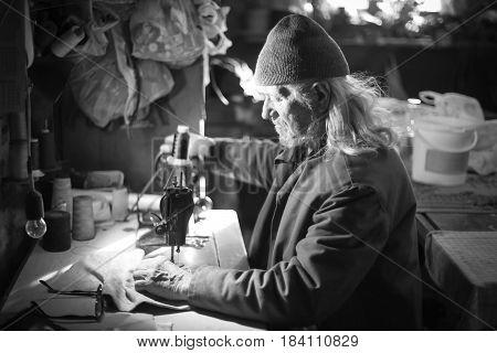 Old Man Sewing Cloth Bw