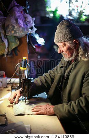 Old Man Sewing